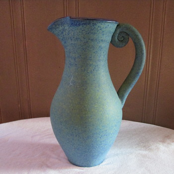 Green blue pitcher with a snail shape in the handle - Pottery