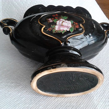 black pottery glass with gold trim and flower applied pink flower red berries 