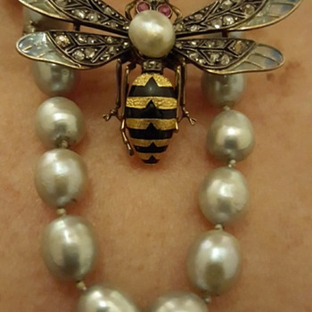 Wasp as necklace + restoration tools used for it.