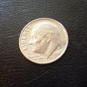 1987P  with circle on cheek, and effects the ear - US Coins