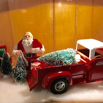 1958 Tonka pickup makes a good tree delivery truck for Santa.