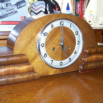 Possibly a Junghans??? Anyone know the identity and age of this clock?