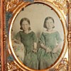 Ambrotype of young girls in green dresses and coral necklaces