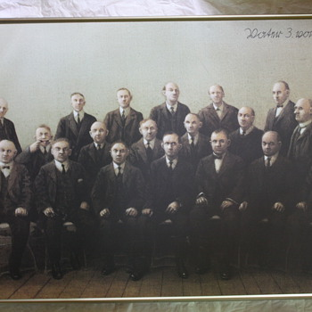 A group photo of stiff men in suits