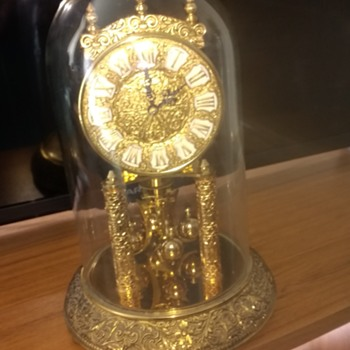 Kieninger & Obergfell Kundo Glass dome protected brass clock very ornate and near silent tick with the revolving pendulem.