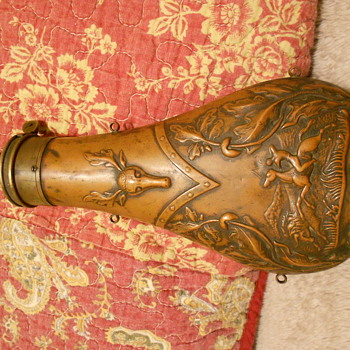 An AM Flask & Cap Co. Black Powder Flask