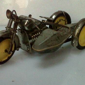 Tin wind up motorcycle with spring action and side car in box..