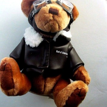 "9 "" Sitting Advertising (Airline & Bank) Teddy Bear--Aviator in faux Leather Jacket - Advertising"