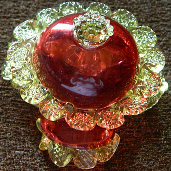 Cranberry with vaseline rigaree and a raspberry prunt salts.  - Art Glass