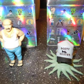 "KidRobot ""Early"" and ""Carl"" vinyl figures"