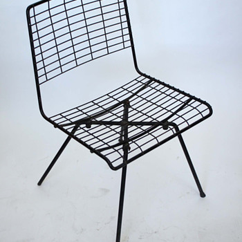 Beautiful bastard chair. Anyone know the designer??