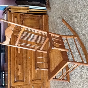Antique 1900ish caned low armed rocking chair