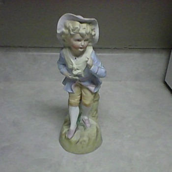 NO. 25 PORCELAIN FIGURINE