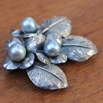 More silver brooches