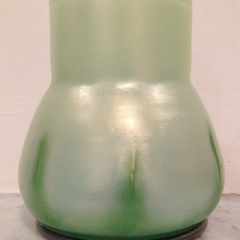 Iridescent glass urn with applied green tadpoles moulded into base