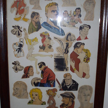 Framed comic and cartoon art.