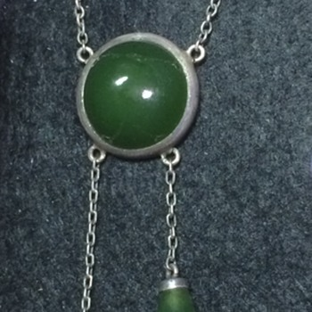 Arts and Crafts silver nephrite jade pendant.