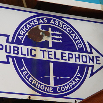 2 Different Arkansas Associated Telephone company signs  - Telephones