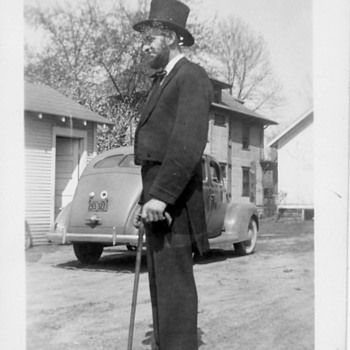 My Great Uncle dressed as Abe Lincoln . Who can date car dates photo ?