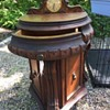 Antique small cabinet with clock
