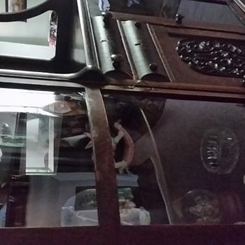 Antique woof and glass cabinet with drawers and shelfs, one drawer is only open by inside need info.