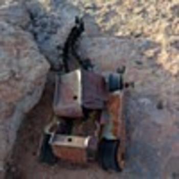 Help me identify a vintage toy bulldozer