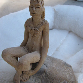 Girl on a rock - Art Pottery