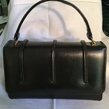 Brown handbag made in Canada -- By Whom?  Leather?
