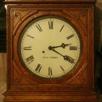 19th c. Seth Thomas wood carved wall clock with custom key entry.