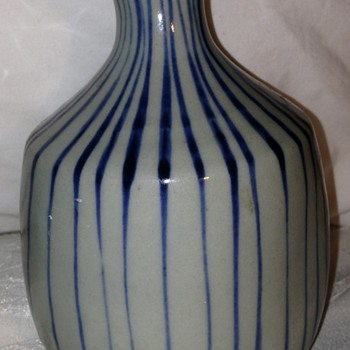 Striped little sake or soy jar