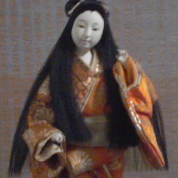 Gofun doll with 2 tone orange kimono.