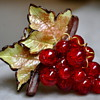 "MARKED ""PARIS"" CARVED CELLULOID OR LUCITE GRAPES WITH LEAVES"
