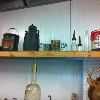 Oil cans and signs