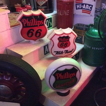 Two Phillips 66 gas globes and a Phillips Unique gas globe - Petroliana