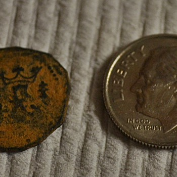 Shipwreck coin found metal detecting