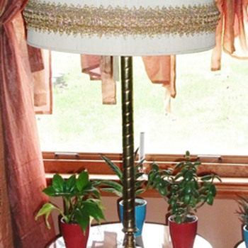 Nice amber glass table lamp and the bottom lights up too.   - Lamps