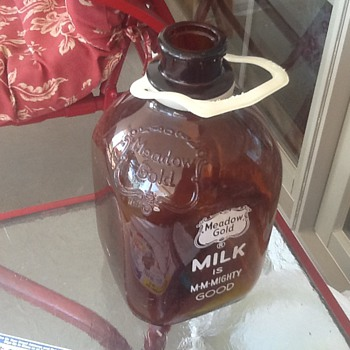My old brown glass Meadow Gold gallon jug. - Bottles