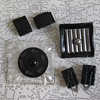 Square, rectangles: Black bakelite, celluloid and metal clips, brooch.