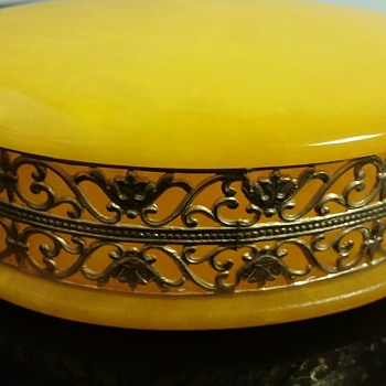 Genuine Alabaster Hand Carved Made in Italy yellow trinket box with gold fill something.