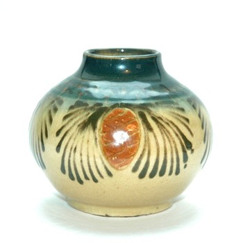 a small art nouveau vase with pine cones pattern by LEON ELCHINGER