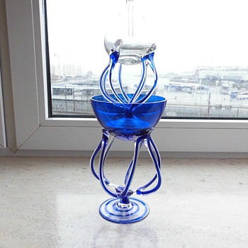 An oil lamp in glass
