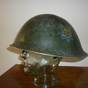 British WWII King's Own Royal Border Regiment steel helmet.
