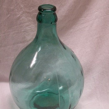 Large blue glass jug bubbles in glass - Bottles