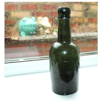 Old green glass bottle 19th century early 20th?