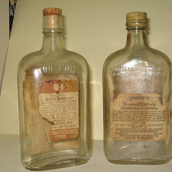 Two old Whiskey Bottles