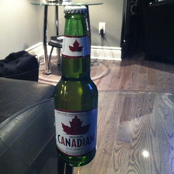 Molson Canadian Beer in a Moosehead bottle - Breweriana