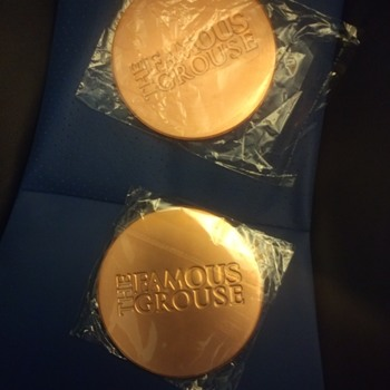 Famous Grouse thats the Whisky, metal coaster type plates with unknown function