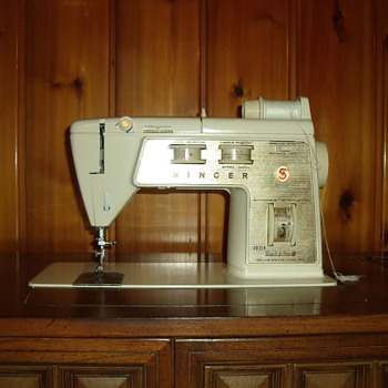 Singer sewing machine in a cabinet