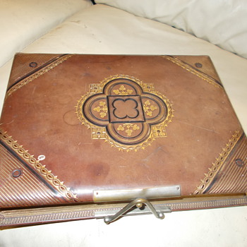 leather and gold leaf photo album. Gem