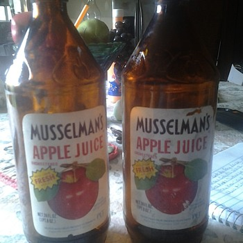 vintage musselman apple juice bottles by anchor hocking